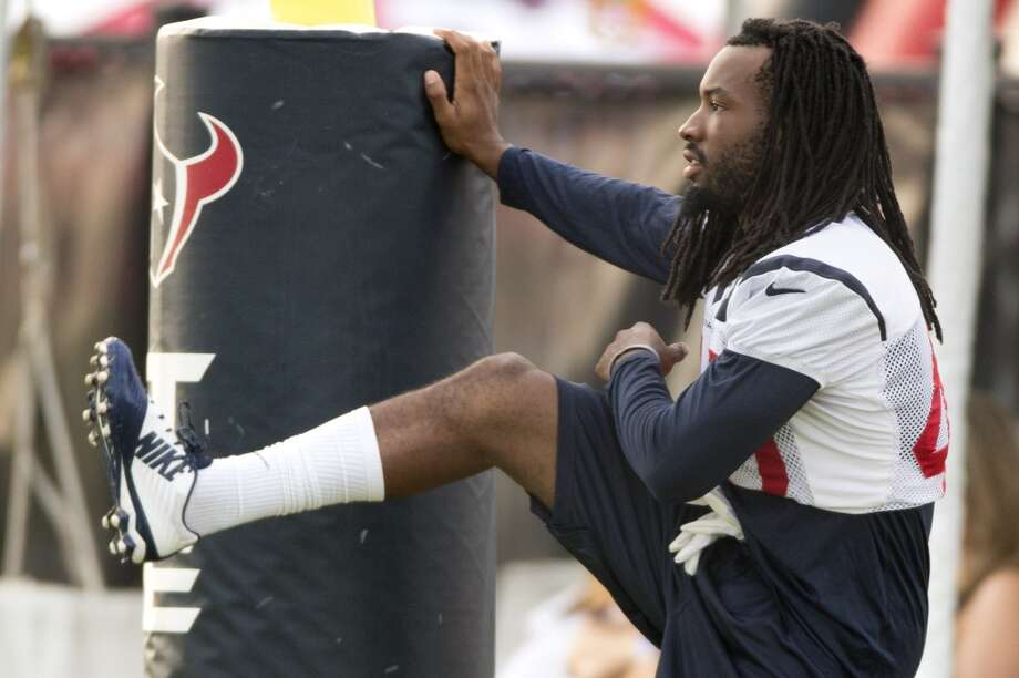 Defensive back Marcus Williams stretches before practice. Photo: Brett Coomer, Houston Chronicle