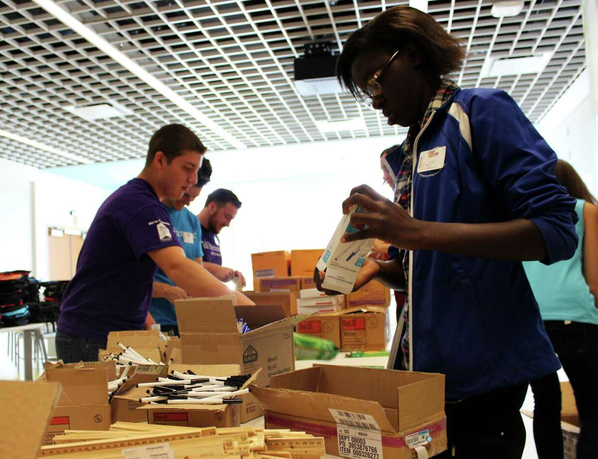 Teen volunteers and Cap Com staff gather school supplies to assemble backpacks for local children in need Monday morning, Aug. 4, 2014, in Albany N.Y. (Selby Smith/Special to the Times Union)