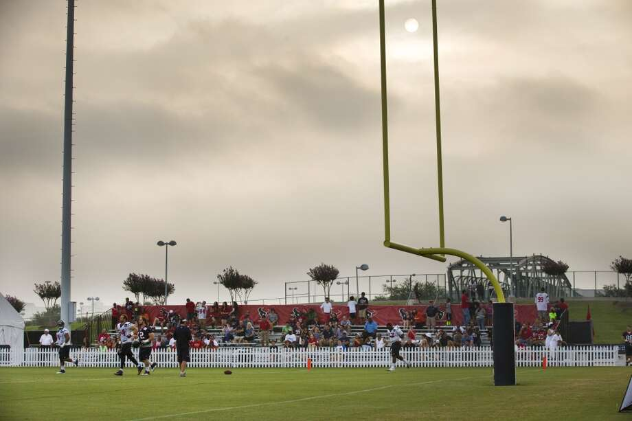 The sun rises above the Texans practice field. Photo: Brett Coomer, Houston Chronicle