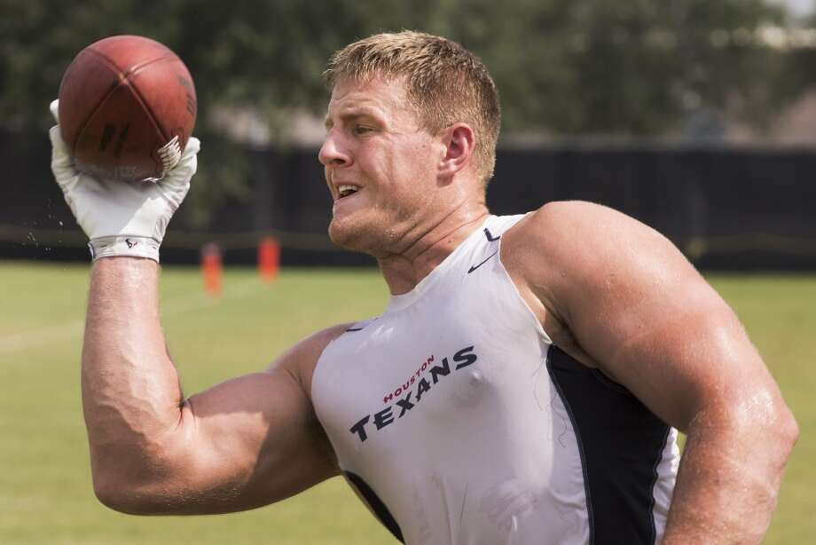 Day 9: August 4   Defensive end J.J. Watt works on catching the football with one hand after practice. Photo: Brett Coomer, Houston Chronicle