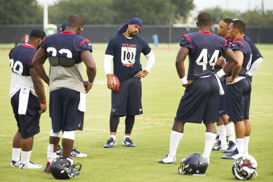 Texans running back Arian Foster, center, stands with the running backs group before practice. Photo: Brett Coomer, Houston Chronicle