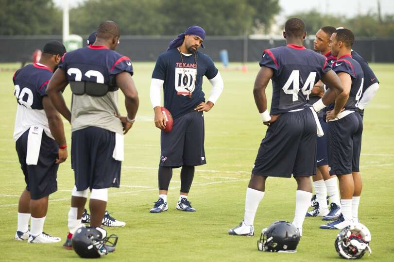 Texans running back Arian Foster, center, stands with the running backs group before practice.