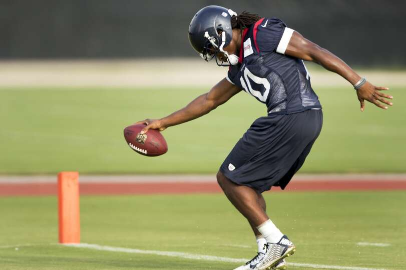 Wide receiver DeAndre Hopkins stretches the football across the goal line after making a catch.