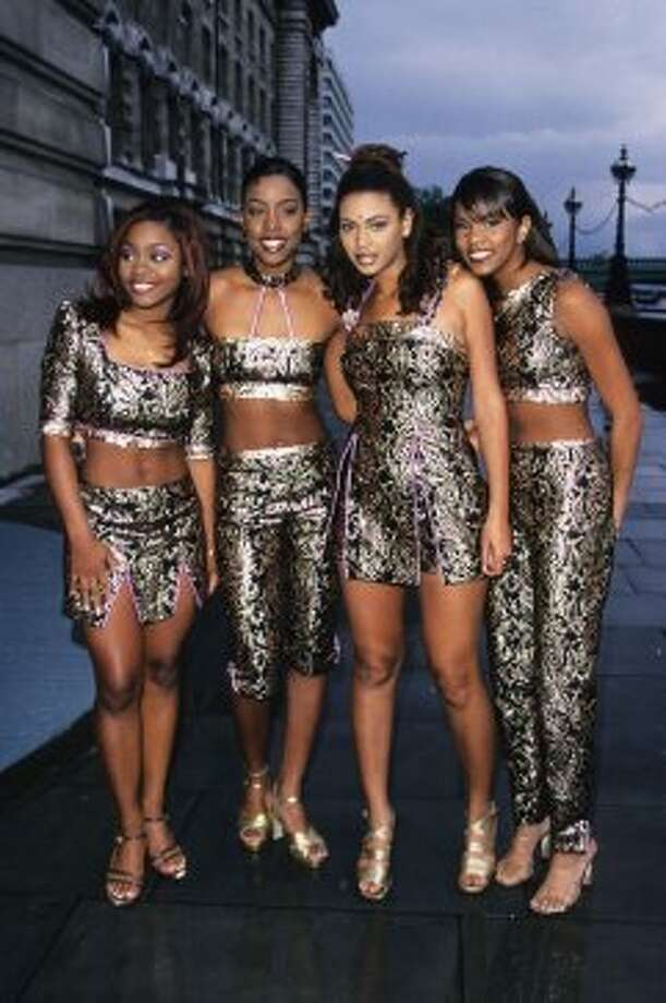 1998:A rare fashion misstep for the Queen Bey in this Destiny's Child original lineup. What's with the dot on her forehead and are those chopsticks in her hair? Maxwell Album launch at the London Aquarium in London. (Photo by Fred Duval/FilmMagic) Photo: Fred Duval, FilmMagic