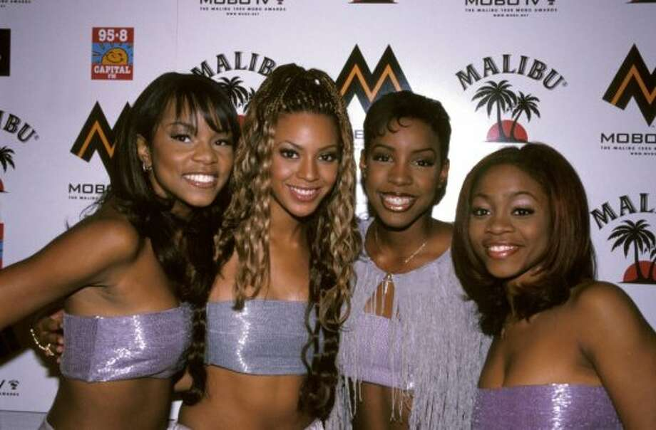 "1999:Beyonce with Destiny's Child in 1999, the year that ""The Writing's on the Wall"" was released and worldwide fame followed. (Photo by Nicky J. Sims/Redferns) Photo: Nicky J. Sims, Redferns"
