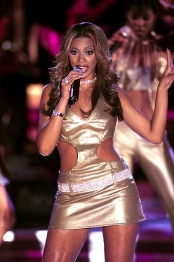 2000:Beyonce is as good as gold with Destiny's Child during the VH1 Divas 2000:  A Tribute to Diana Ross at the Theater at Madison Square Garden in New York. Photo: Frank Micelotta, Getty Images