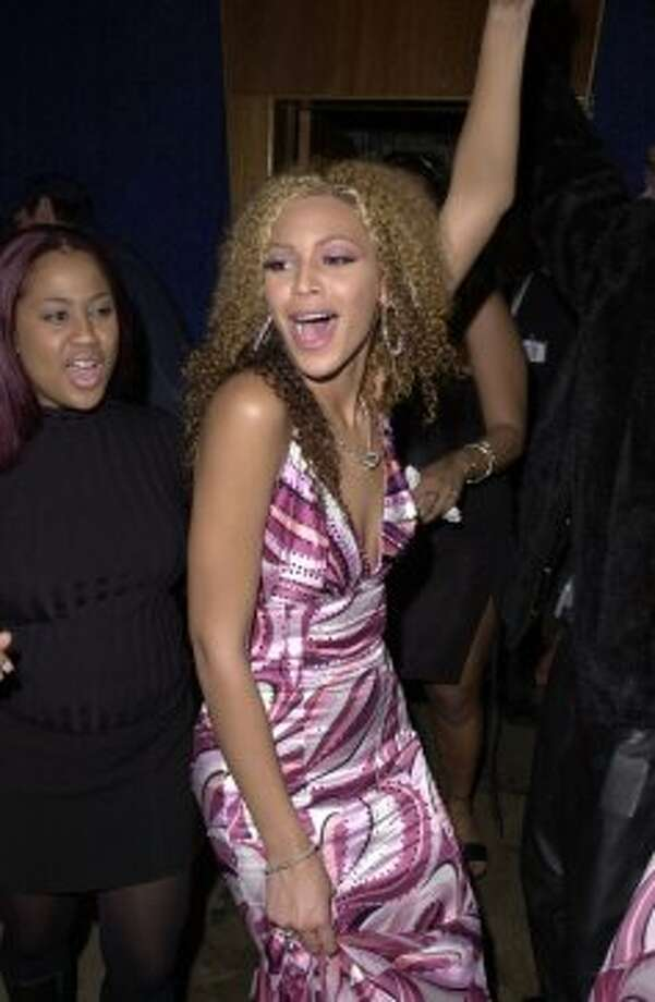 2001:Beyonce lets loose during her Destiny's Child days at the 28th Annual American Music Awards - Columbia Records After Party at Las Palmas in Hollywood, California. ***Exclusive*** (Photo by J. Vespa/WireImage) Photo: J. Vespa, WireImage