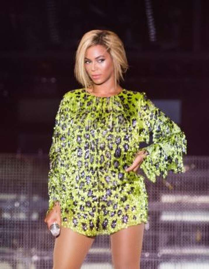 2013:A rare short hair style frames Beyonce's flawless facee at the V Festival at Hylands Park on Aug. 17, 2013 in Chelmsford, England. (Photo by Samir Hussein/WireImage) Photo: Samir Hussein, WireImage