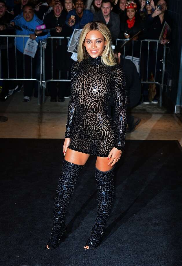 "2013:Beyonce's every curve stands out at her release party and screening for her new self-titled album ""Beyonce"" at the School of Visual Arts Theater on Dec. 21, 2013 in New York City.  (Photo by James Devaney/WireImage) Photo: James Devaney, WireImage"