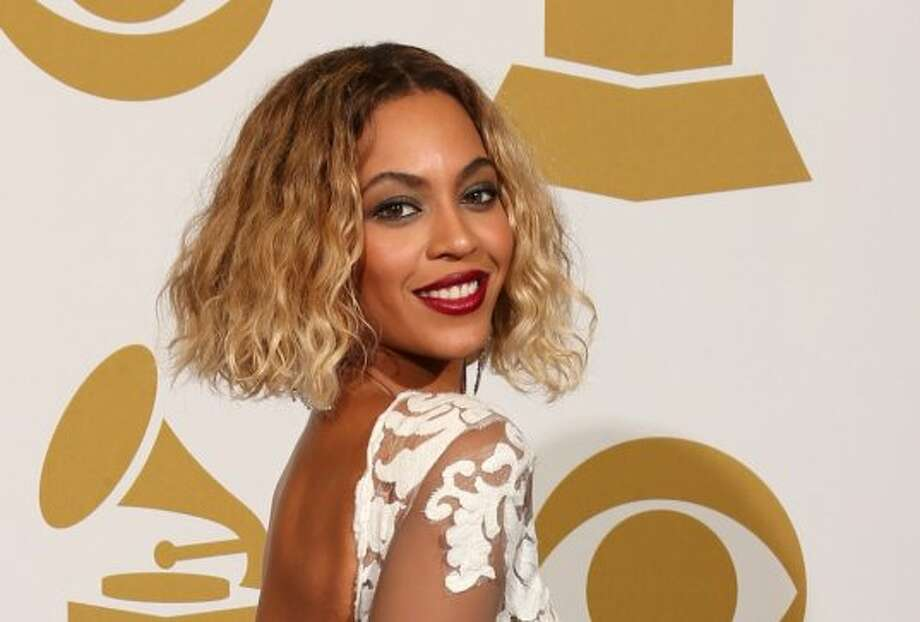 2014:Short hair returns for 2014 as Beyonce poses for photos at the 56th Annual Grammy Awards at Staples Center on Jan. 26, 2014, in Los Angeles, California. (Photo by Dan MacMedan/WireImage) Photo: Dan MacMedan, WireImage