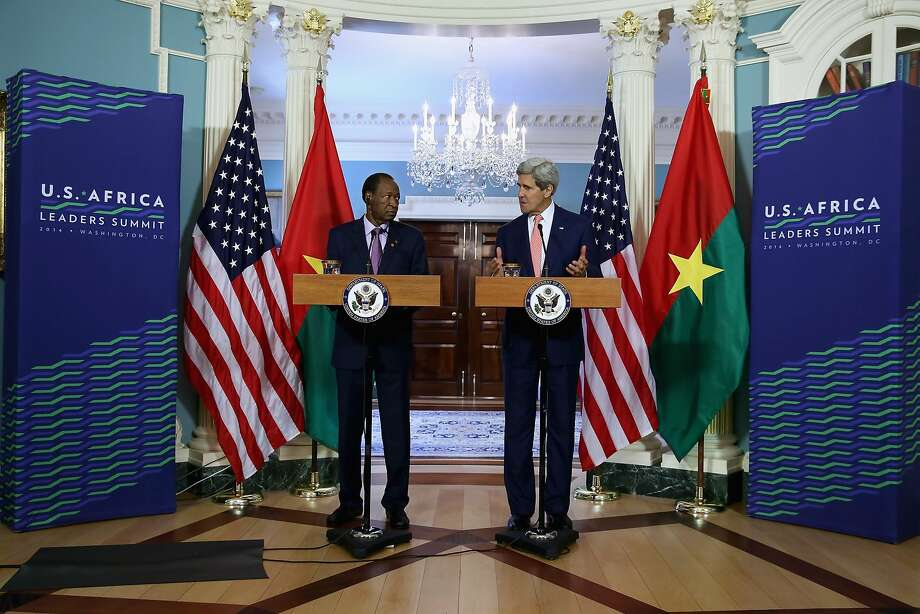 Secretary of State John Kerry (right) and Burkina Faso President Blaise Campaore address the media before a bilateral meeting at the summit. Photo: Chip Somodevilla, Getty Images