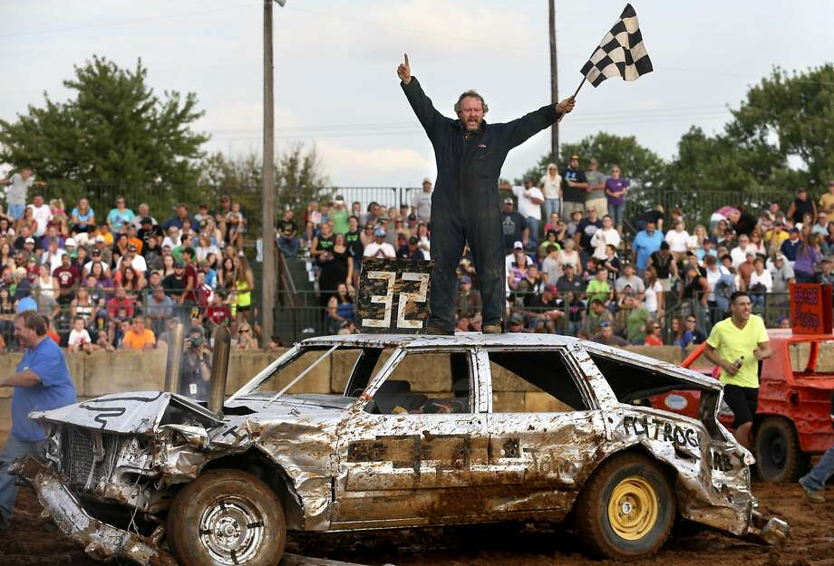 Don't do that, you'll dent the roof!Joey Montz Jr. jumps on top of his Chevy station wagon 