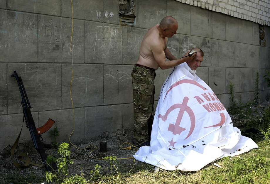 Repurposed flag: Ukrainian volunteer soldiers find a good use for a Ukrainian Communist Party flag after freeing 