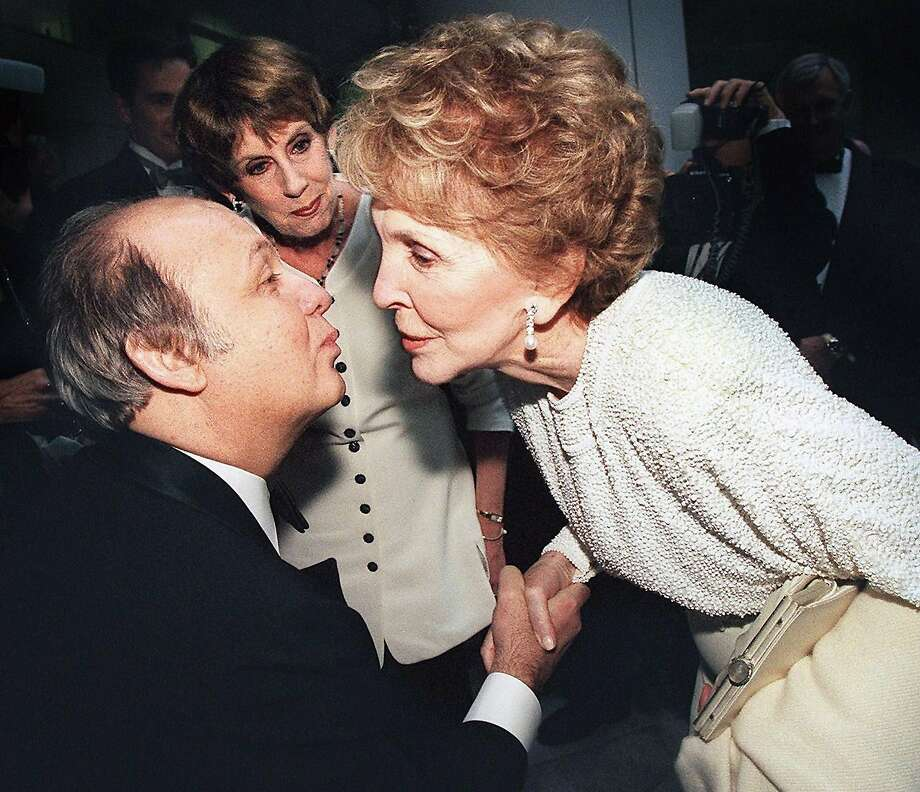 Jim Brady is greeted by former first lady Nancy Reagan in Washington in 1999. Photo: Tim Sloan, AFP/Getty Images