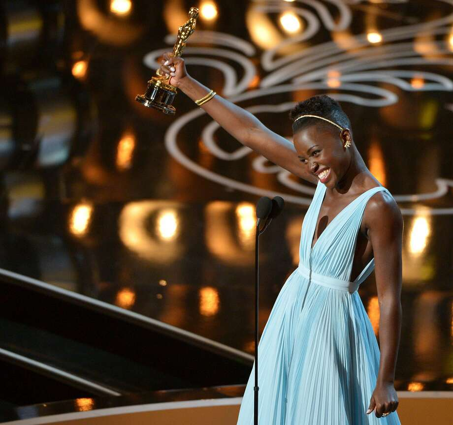 "FILE - This March 2, 2014, file photo shows Lupita Nyong'o accepting the award for best actress in a supporting role for ""12 Years a Slave"" during the Oscars at the Dolby Theatre in Los Angeles. 2013 was called a banner year for black actors, due to the success of films such as ?Fruitvale Station,? ?Lee Daniels' The Butler? and ?12 Years a Slave,? which made Steve McQueen the first black winner of the best-director Oscar. (Photo by John Shearer/Invision/AP, File) Photo: John Shearer, Associated Press"