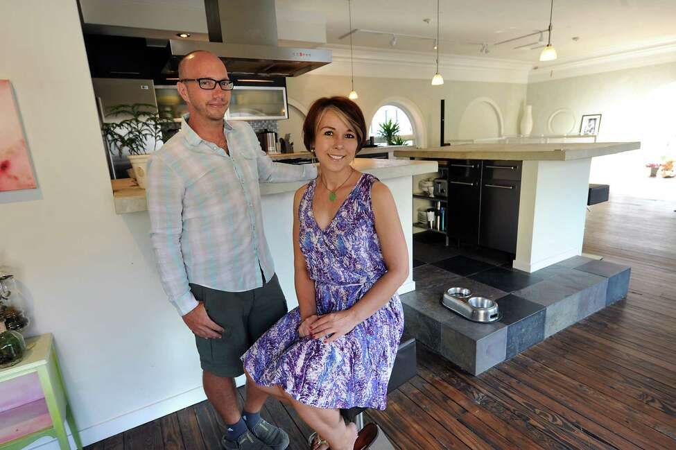 Jesse Matulis and Alana Sparrow pose in front of their kitchen they built on Wednesday, July 9, 2014 in Cohoes, N.Y. The couple lives above The Foundry for Art Design + Culture which is an event gallery they own. (Lori Van Buren / Times Union)