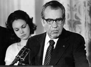 FILE -- President Richard M. Nixon says an emotional goodbye to his Cabinet and staff at the White House on Aug. 9, 1974. At left is his daughter, Julie Nixon Eisenhower. Nixon was driven from office by the Watergate scandal, resigning in the face of certain impeachment.