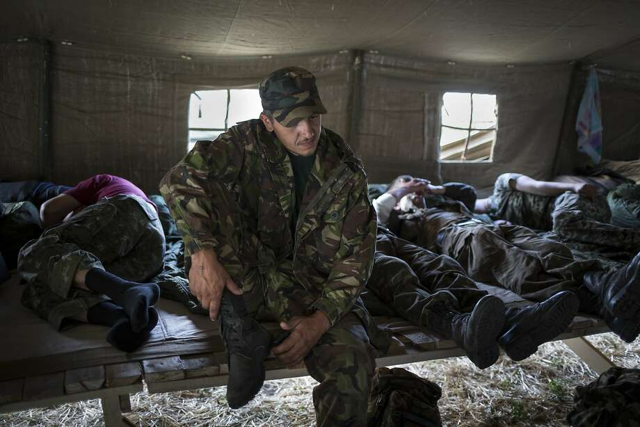 Ukrainian soldiers who fled conflict in the country rest in a tent camp just outside the village of Gukovo in the Rostov-on-Don region of southern Russia. Photo: Alexander Zemlianichenko, Associated Press