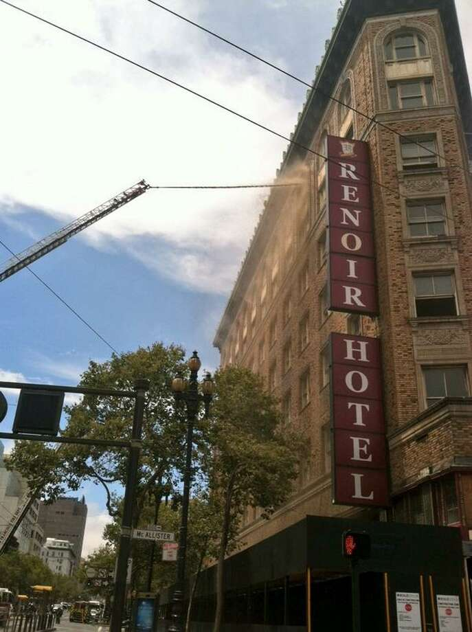 SF fire crews blast water into SF's Renoir Hotel. Photo: Evan Sernoffsky, The Chronicle