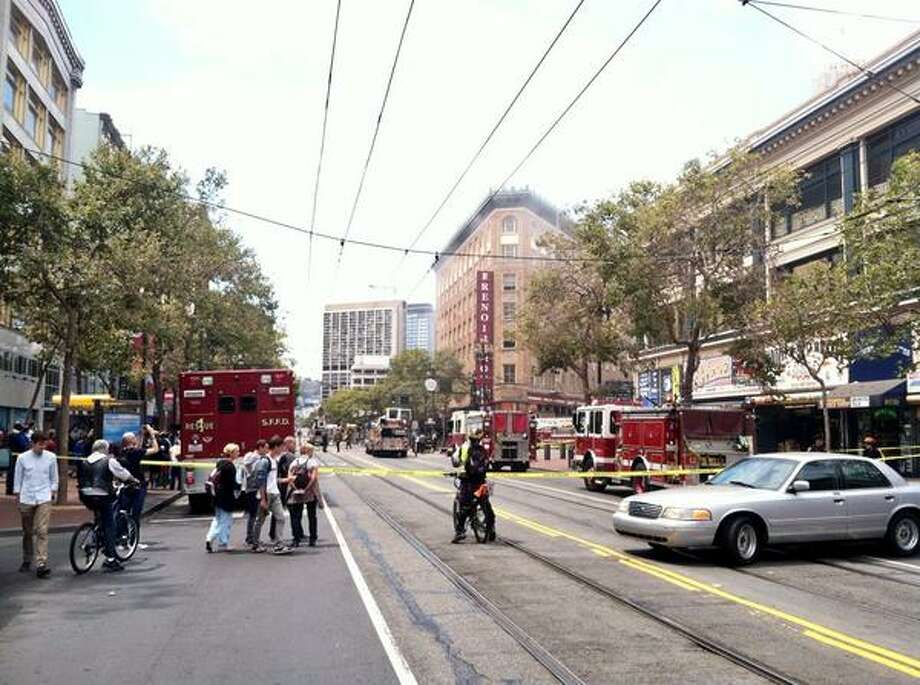 Market closed from 6th to 8th as crews battle a fire at the Renoir Hotel. Photo: Evan Sernoffsky, The Chronicle