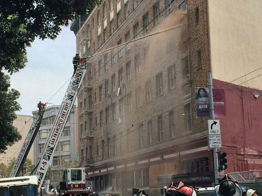 San Francisco fire crews douse the Renoir Hotel. Photo: Evan Sernoffsky
