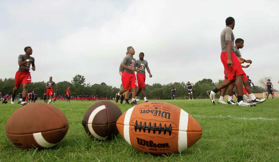 Members of the Pearland Dawson football team practice on Monday, Aug. 4, 2014, in Pearland. Photo: J. Patric Schneider, For The Chronicle / © 2014 Houston Chronicle