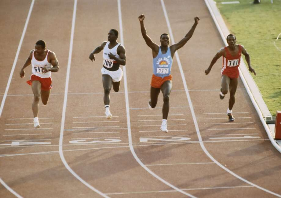 TRIALS: Carl Lewis #387 wins the final of the Men's 100m event  during 1984 United States Olympic Track and Field Trials at the Los Angeles Memorial Coliseum on June 17, 1984 in Los Angeles, California .  Also visible are Ron Brown #647, Emmit King #708 and Calvin Smith #711. (Photo by David Madison/Getty Images) Photo: David Madison, Getty Images