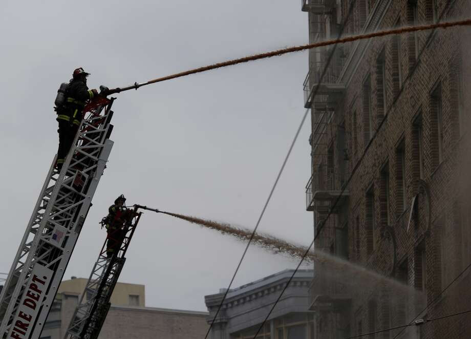 Two hoses were trained on the north side of the building Monday August 4, 2014. San Francisco firefighters battled a smokey fire at the shuttered Renoir Hotel on McAllister Street. Fire crews closed Market Street and adjoining avenues pouring water into the hotel. Photo: San Francisco Chronicle