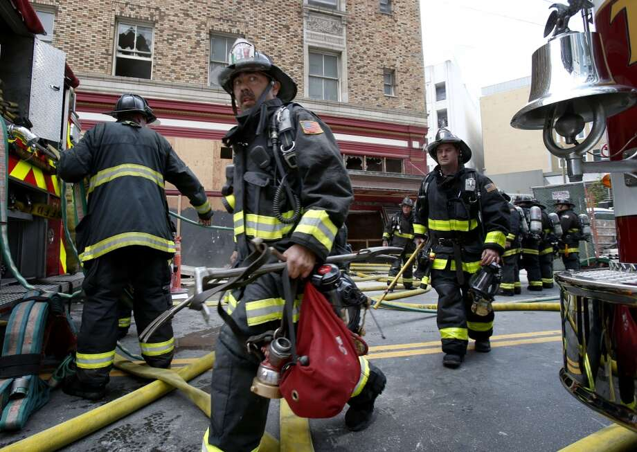 At least three alarms were called as fire fighters flooded the streets in front of the hotel Monday August 4, 2014. San Francisco firefighters battled a smokey fire at the shuttered Renoir Hotel on McAllister Street. Fire crews closed Market Street and adjoining avenues pouring water into the hotel. Photo: San Francisco Chronicle