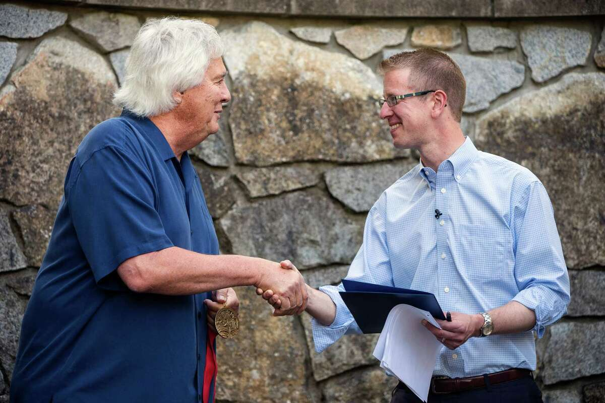 Representative Derek Kilmer, right, will chair the centerist New Democrat Coalition in the new Congress. Here, thanks National Humanities Medal winning architect Johnpaul Jones, left, for his work on the newly renamed Bainbridge Island Japanese American Exclusion Memorial Monday, August 4, 2014, on Bainbridge Island, Wash. The site, designed by National Humanities Medal winning architect Johnpaul Jones, is the only national memorial to the internment of Japanese Americans not located at an incarceration site.