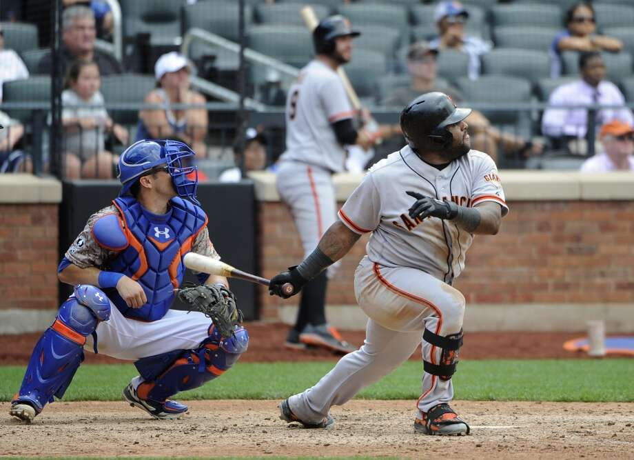 New York Mets catcher Travis d'Arnaud and San Francisco Giants' Pablo Sandoval watch Sandoval's ground-rule double that scored Gregor Blanco for the winning run in the ninth inning. Photo: Kathy Kmonicek, Associated Press