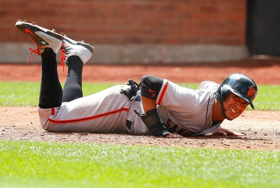 Gregor Blanco of the San Francisco Giants reacts after being tagged out trying to score on teammates Pablo Sandoval (not pictured) single in the seventh inning. Photo: Mike Stobe, Getty Images