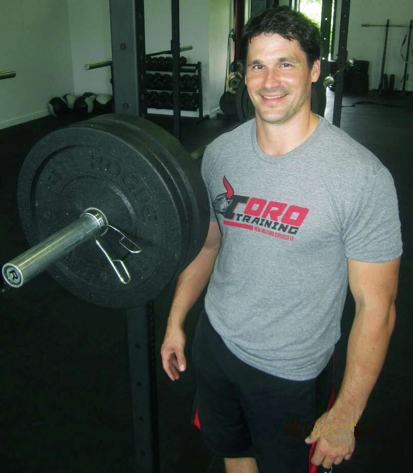 Rob Ebin of New Milford brings a wealth of training and athletic experience to his Cross Fit business. August 2014 Photo: Norm Cummings / The News-Times