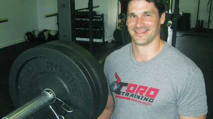 Rob Ebin of New Milford brings a wealth of training and athletic experience to his Cross Fit business. August 2014