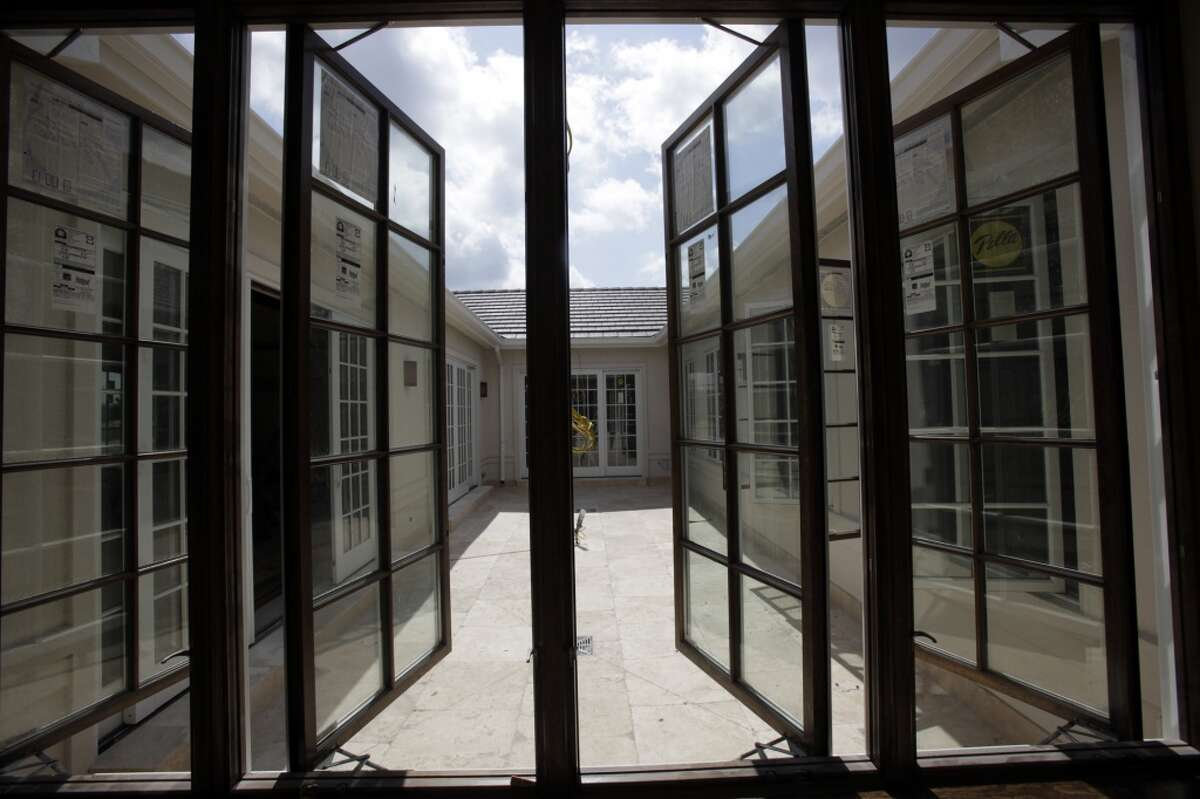 A series of windows offer a view of the central courtyard as construction continues at the Good Shepherd Center, future home of Archbishop Jose Gomez, Tuesday, June 2, 2009.The center is now home to Archbishop Gustavo Garcia-Siller.