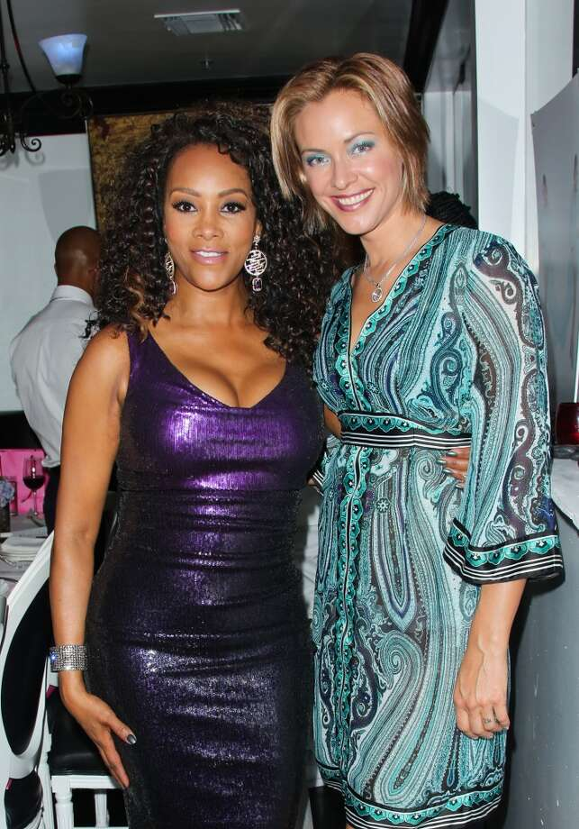 Actress Vivica A. Fox (L) and Kristanna Loken (R) attend Vivica A. Fox's 50th birthday celebration at Philippe Chow on August 2, 2014 in Beverly Hills, California. Photo: Paul Archuleta, FilmMagic