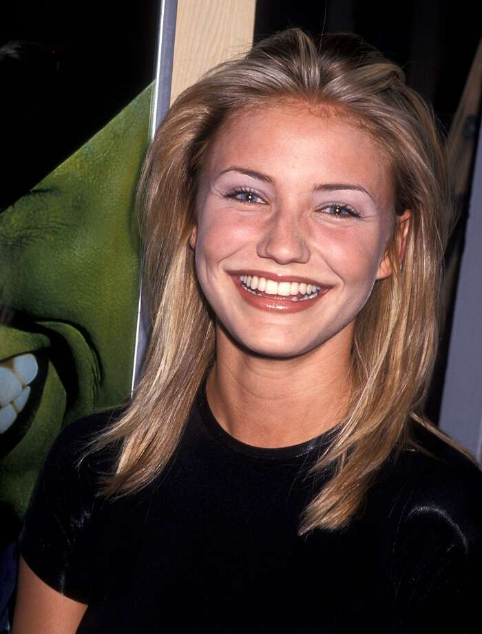 Alllllrighty then. Cameron Diaz', pictured here in 1994, first movie role ever was opposite Jim Carrey in 1994's 'The Mask.'