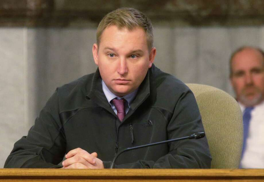 FILE - In this Monday, Dec. 2, 2013 file photo, Cincinnati city councilman Chris Seelbach at a council meeting in Cincinatti. Seelbach lead a years-long effort to gain repeal in 2004 of the city's 11-year-old ban on gay rights laws. and became the city's first openly gay councilman in 2011. The 6th U.S. Circuit Court of Appeals will hear arguments Wednesday, Aug. 6, 2014, in Cincinnati about the constitutionality of marriage bans in Ohio, Michigan, Kentucky and Tennessee. Cincinnati has been the scene before of heated debate over gay rights.(AP Photo/Al Behrman, File) Photo: Al Behrman, STF / AP