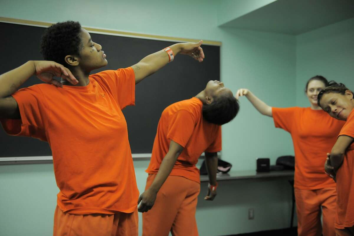 From left, inmates Demetrius Carroll, Erica Jones, Tasha Anderson and Marisabela Sarria dance during a