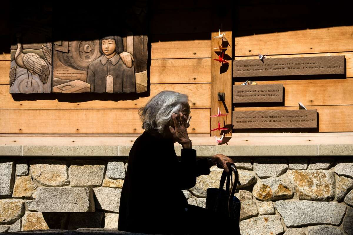 Wiping away a tear, Yukiko Nakamura, a Japanese American survivor of the World War II internment camps, visits the site of the newly renamed Bainbridge Island Japanese American Exclusion Memorial Monday, August 4, 2014, on Bainbridge Island, Wash. The site, designed by National Humanities Medal winning architect Johnpaul Jones, is the only national memorial to the internment of Japanese Americans not located at an incarceration site. (Jordan Stead, seattlepi.com)