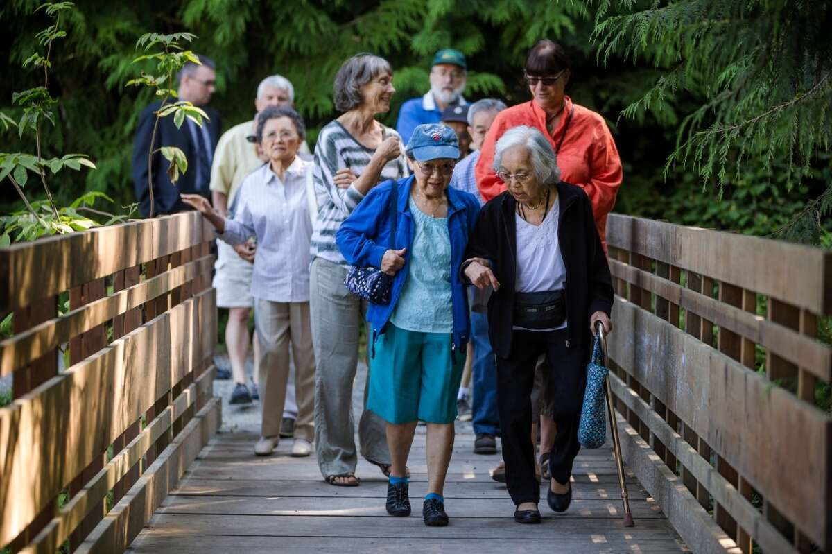 Yukiko Nakamura, right, a Japanese American survivor of the World War II internment camps, is walked by her friend, Kathleen Yukawa, center, to visit the site of the newly renamed Bainbridge Island Japanese American Exclusion Memorial Monday, August 4, 2014, on Bainbridge Island, Wash. The site, designed by National Humanities Medal winning architect Johnpaul Jones, is the only national memorial to the internment of Japanese Americans not located at an incarceration site. (Jordan Stead, seattlepi.com)