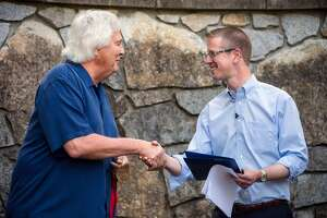 Representative Derek Kilmer, right, thanks National Humanities Medal winning architect Johnpaul Jones, left, for his work on the newly renamed Bainbridge Island Japanese American Exclusion Memorial Monday, August 4, 2014, on Bainbridge Island, Wash. The site, designed by National Humanities Medal winning architect Johnpaul Jones, is the only national memorial to the internment of Japanese Americans not located at an incarceration site. (Jordan Stead, seattlepi.com)