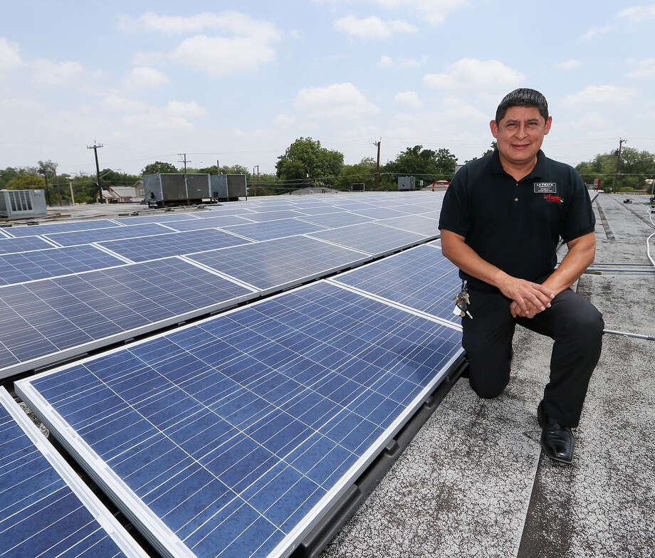 La Fiesta store manger Robert Contreras shows some of the 129 solar panels on the roof at the South Flores store. The store expects to save 10 to 15 percent on its utility bill. Photo: Marvin Pfeiffer / Southside Reporter / EN Communities 2014