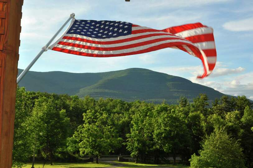 With a rural and hilly backdrop, Old Glory waves over Saugerties this summer in a photo by Charles H