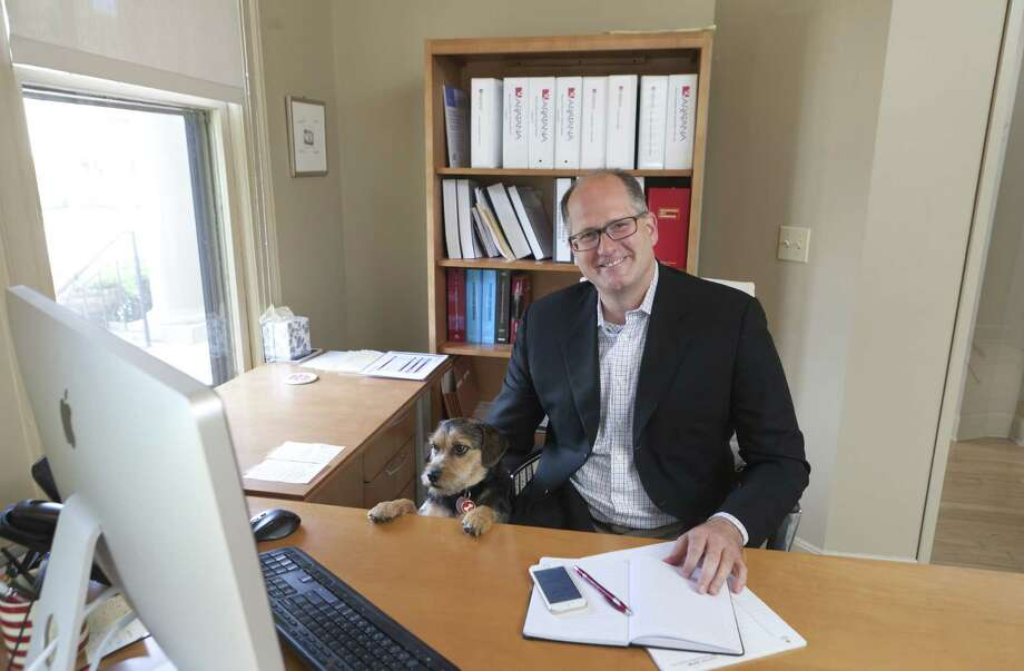 Dr. Steven St. Peter — CEO of Aratana Therapeutics, a pet biotech company — is at work with his dog Flo in Kansas City, Kan. Photo: Dan Gill / New York Times / NYTNS