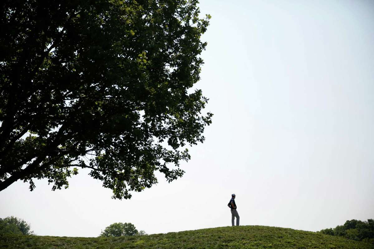 Alex Depallo stands atop a hill and looks over the 18th green at the PGA Championship golf tournament at Valhalla Golf Club Monday, Aug. 4, 2014, in Louisville, Ky. The tournament is set to begin on Thursday. (AP Photo/Jeff Roberson) ORG XMIT: KYJR104