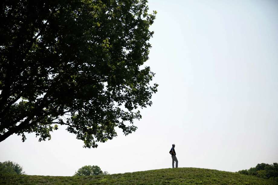 Alex Depallo stands atop a hill and looks over the 18th green at the PGA Championship golf tournament at Valhalla Golf Club Monday, Aug. 4, 2014, in Louisville, Ky. The tournament is set to begin on Thursday. (AP Photo/Jeff Roberson)  ORG XMIT: KYJR104 Photo: Jeff Roberson / AP