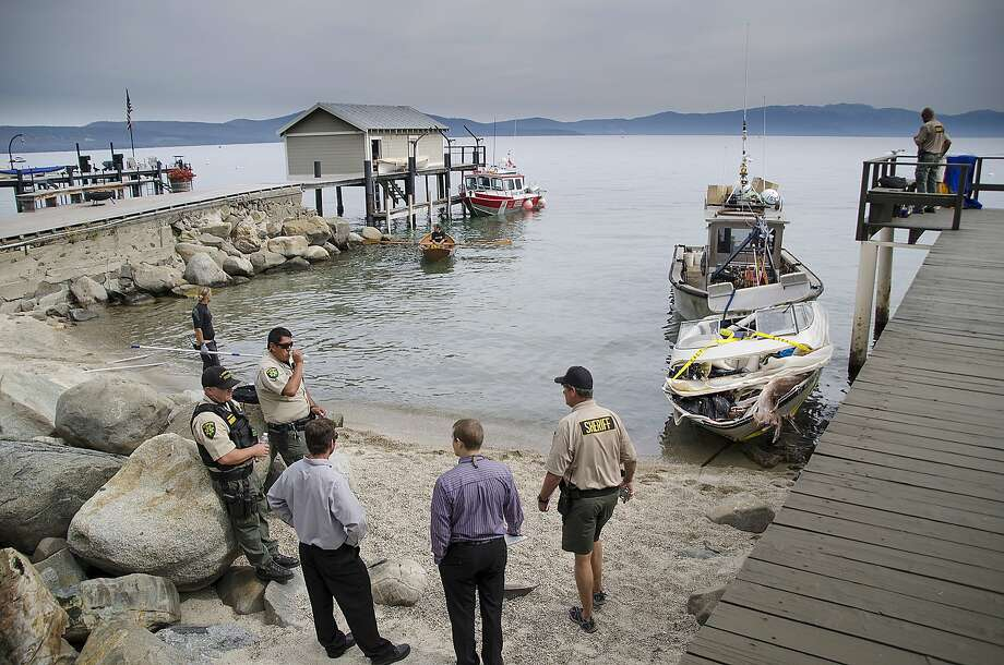 In this Aug. 3, 2014 photo, El Dorado County sheriff's officials work next to a boat that crashed into a dock at Lake Tahoe in Meeks Bay, Calif. Authorities say a husband and wife are dead after their boat crashed into a Lake Tahoe dock a little before 2 a.m. Sunday near Meeks Bay. (AP Photo/Marlena Sloss) Photo: Marlena Sloss, Associated Press