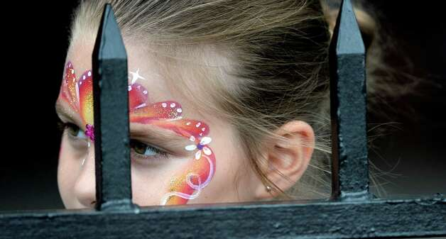 Graison Lenfest, 7, of Glenville shows off her face painting artwork she received Monday, Aug. 5, 2014, at  Saratoga Race Course in Saratoga Springs, N.Y.   (Skip Dickstein/Times Union) Photo: SKIP DICKSTEIN