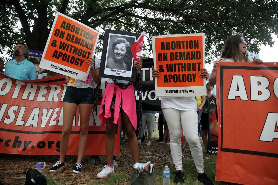 Abortion-rights activists rally near the Austin courthouse where a hearing on Texas' law began Monday. Photo: Reshma Kirpalani